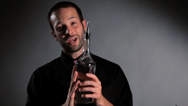 C. How to Do the Flat behind the Back Flair Bartending Move Promo Image
