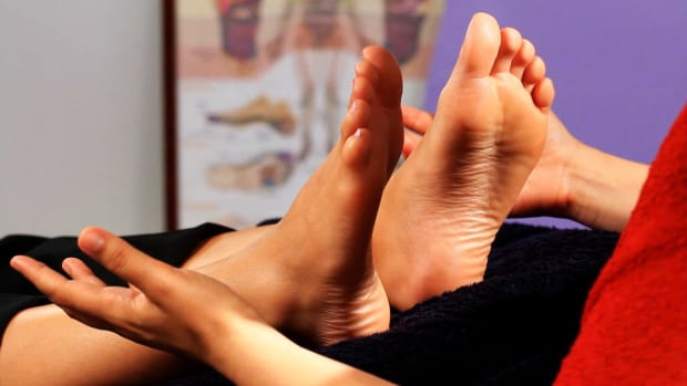 C. How to Position Yourself to Do Reflexology on a Foot Promo Image