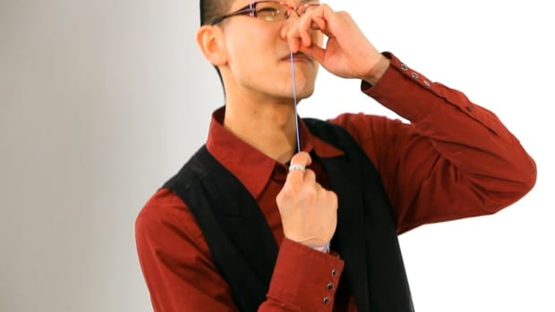 E. How to Do the Rubber Band Up Your Nose Office Magic Trick Promo Image