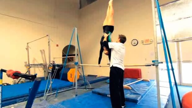 T. How to Do a Cast Handstand Drill in Gymnastics Promo Image