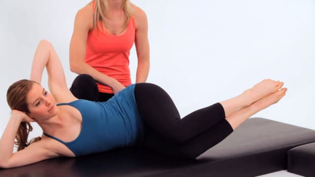 ZZG. How to Do the Side Kick Fetal Five in Pilates Promo Image