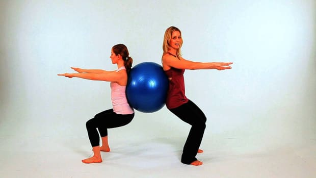 K. How to Do a Wall Squat in Pilates Promo Image