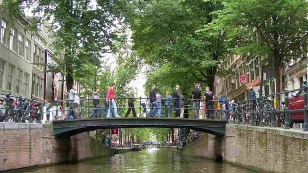 A. Top 4 Neighborhoods to Visit in Amsterdam Promo Image