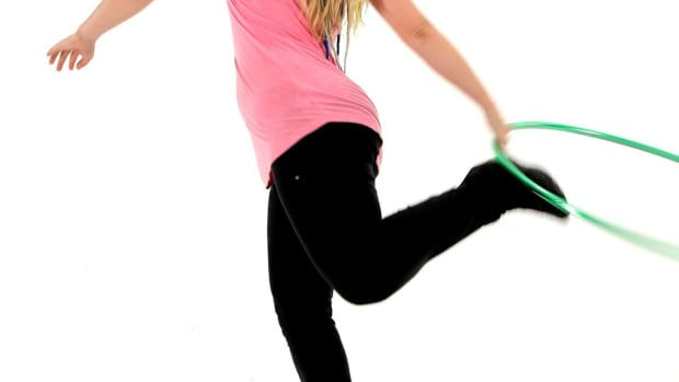 ZI. How to Do a Hula Hoop Foot Pass Promo Image
