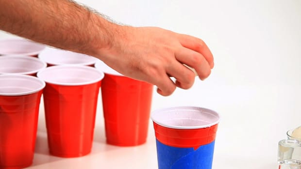 A. How to Play the Drinking Game Beer Pong Promo Image