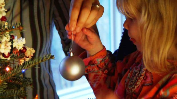 N. How to Hang Ornaments on a Christmas Tree Promo Image