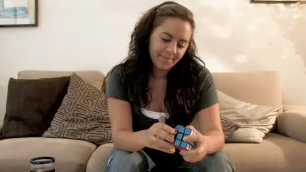 A. How to Solve a Rubik's Cube Promo Image