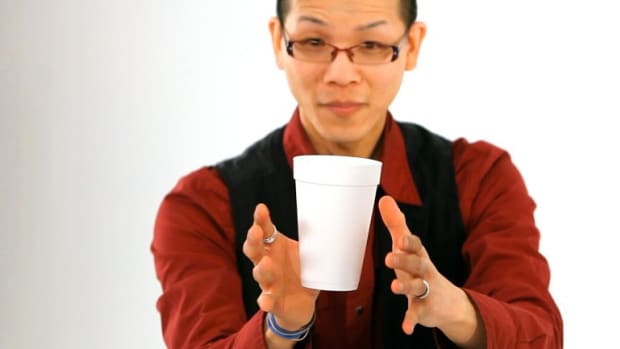 N. How to Do the Floating Coffee Cup Office Magic Trick Promo Image