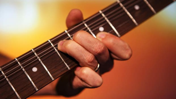 B. How to Play Fingerstyle Guitar Promo Image