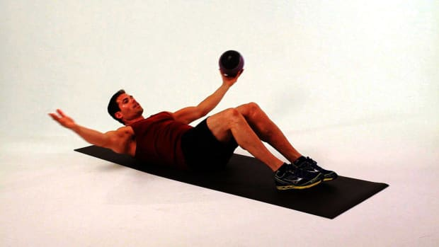 Y. How to Do One-Arm Alternating Sit-Ups with a Medicine Ball Promo Image