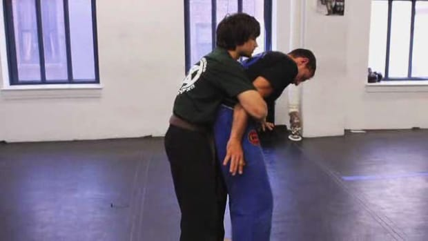 E. Defend against a Rear Bear Hug with Arms Pinned in Krav Maga Promo Image