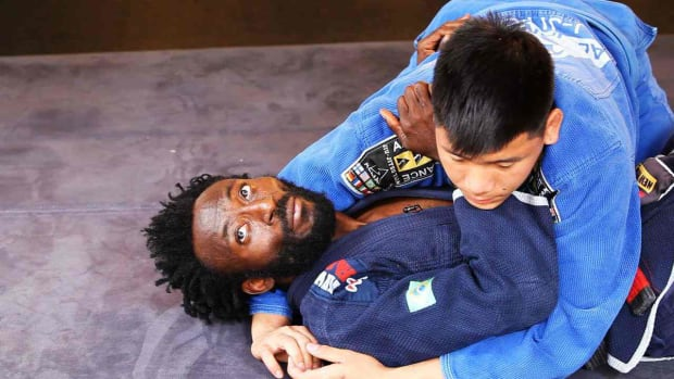 W. How to Escape from a Side Mount in Brazilian Jiu Jitsu Promo Image