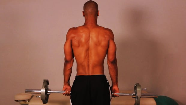 F. How to Do a Standing Barbell Shrug for a Back Workout Promo Image