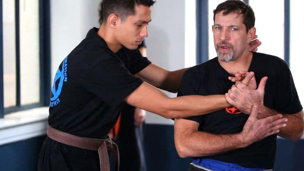 S. How to Defend against a Side Choke in Krav Maga Promo Image