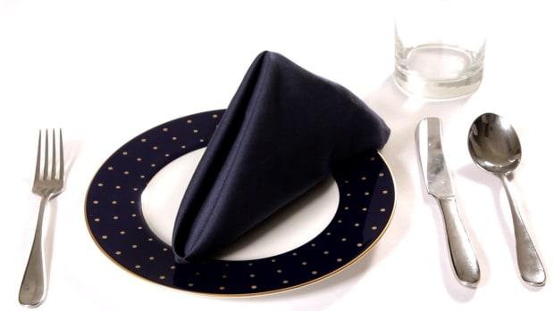 ZG. How to Fold a Napkin into a Classic Pyramid Promo Image