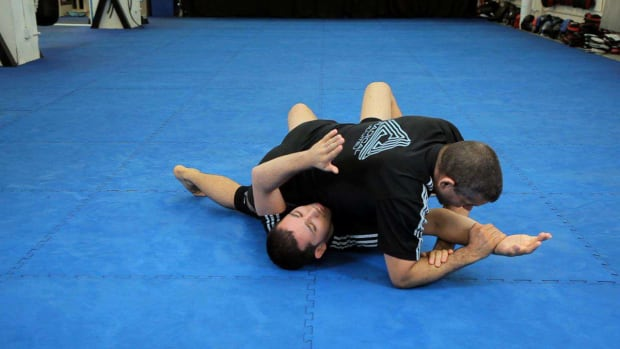 X. How to Do a Straight Arm Lock from Mount MMA Submission Promo Image