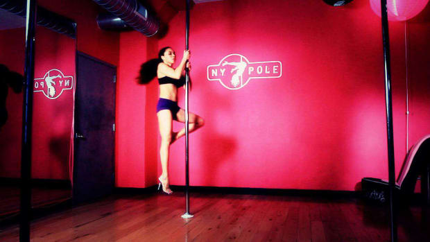 G. How to Do a Narrow Grip Single Stag Static Pole Dance Spin Promo Image