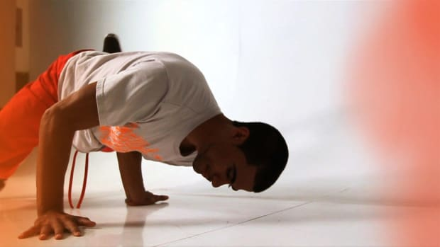 ZB. How to Do a Baby Freeze to a Headstand Promo Image