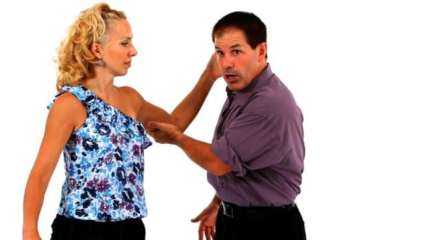 O. How to Do an East Coast Swing Elbow Turn in Swing Dance Promo Image