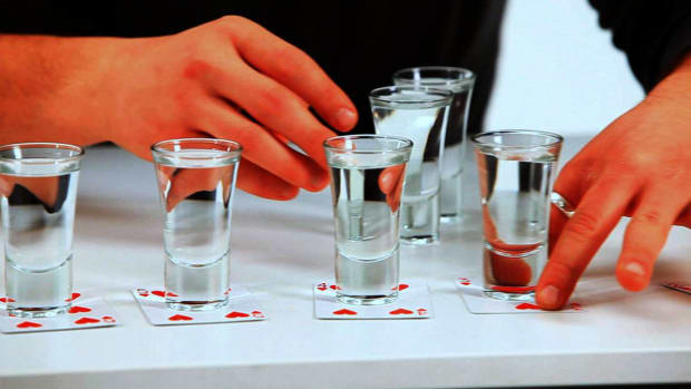K. How to Play the Drinking Game Russian Roulette with Liquor Promo Image