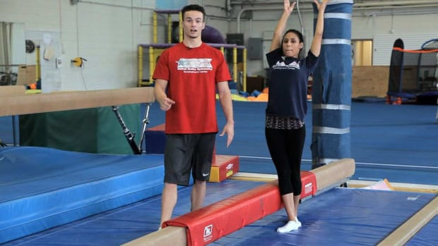 Y. How to Do a Back Walkover on the Balance Beam Promo Image