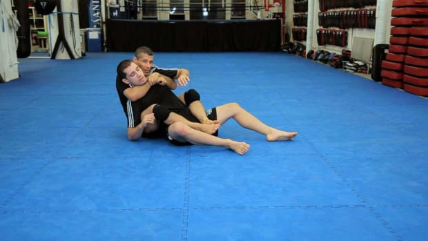 ZX. How to Do a Rolling Arm Bar from Back Mount MMA Submission Promo Image