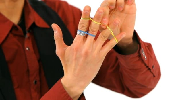 F. How to Do the Jumping Rubber Band Office Magic Trick Promo Image
