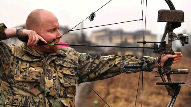 R. How to Use a Modern Compound Bow in Archery Promo Image