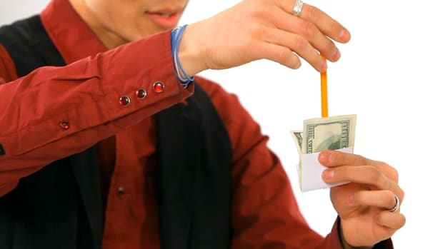 Q. How to Do the Pencil through a Dollar Office Magic Trick Promo Image