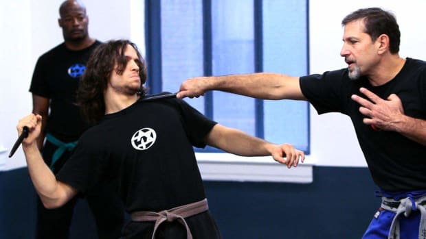 ZA. Defend Yourself against an Overhead Knife Strike in Krav Maga Promo Image