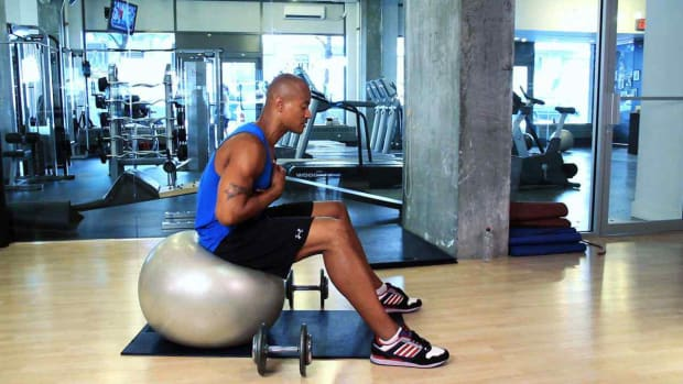 N. How to Do Stability Ball Exercises at the Gym Promo Image