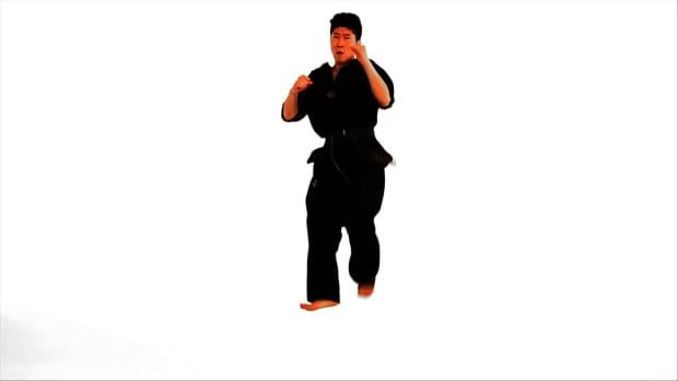 N. How to Do a Jump Axe Kick in Taekwondo Promo Image