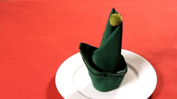 ZD. How to Fold a Napkin into an Elf Hat Promo Image