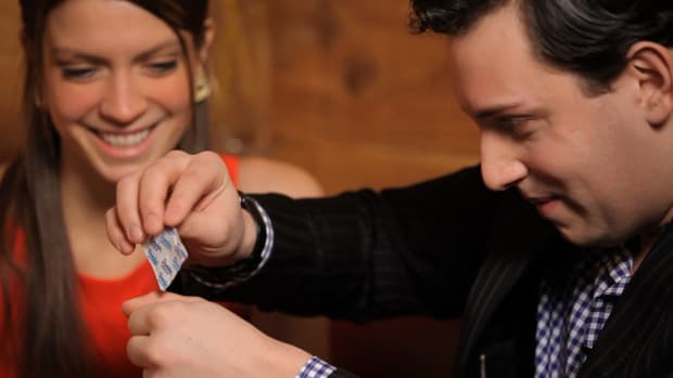 T. How to Make a Sugar Packet Disappear into Your Palm Promo Image