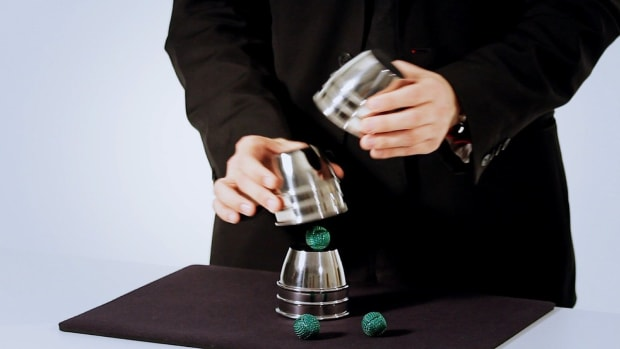 ZK. How to Do the Classic Cups & Balls Magic Trick Promo Image