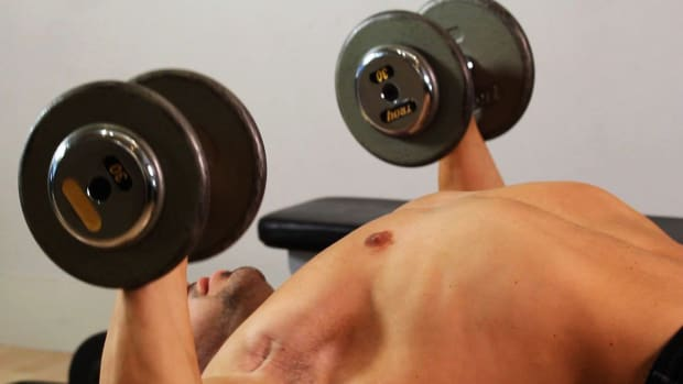 ZL. How to Do a Stability Ball Dumbbell Press for an Arm Workout Promo Image