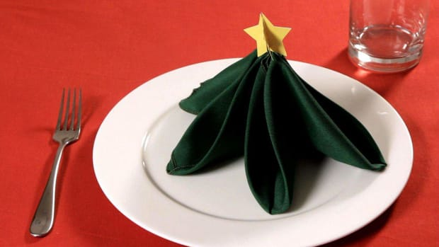 ZA. How to Fold a Napkin into a Christmas Tree Promo Image