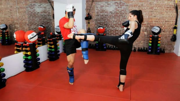 V. How to Do a Roundhouse Kick Defense in Kickboxing Promo Image