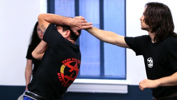 ZJ. How to Defend Yourself against a Back Hair Pull in Krav Maga Promo Image