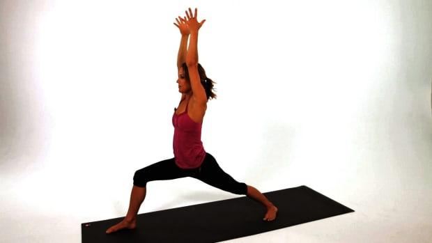 K. How to Do a Warrior One (Virabhadrasana I) Yoga Pose Promo Image