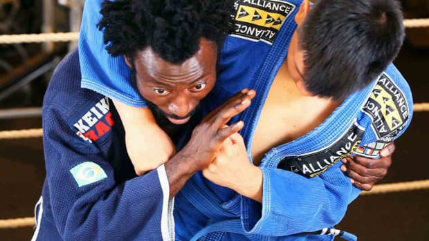 A. How to Get Out of a Standing Side Headlock in Jiu Jitsu Promo Image