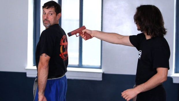 V. How to Defend Yourself against a Gun from Rear in Krav Maga Promo Image