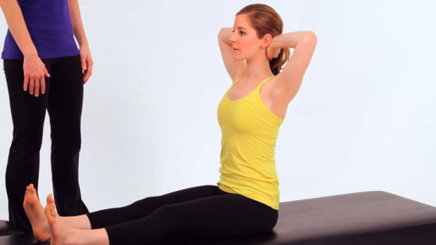 ZM. How to Do the Neck Pull in Pilates Promo Image