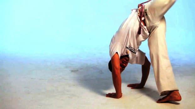 O. How to Do the Meia Lua de Compasso in Capoeira Promo Image
