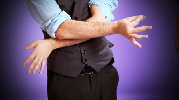 O. How to Do the Coin through the Elbow Magic Trick Promo Image