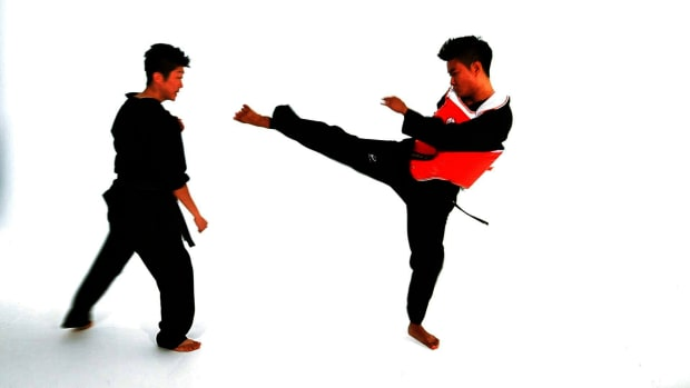 ZC. How to Do the Step Forward Step Back Taekwondo Technique Promo Image