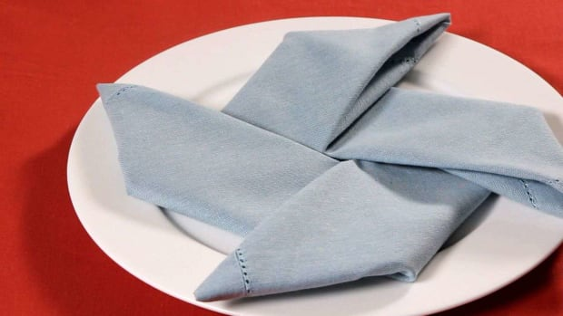 ZF. How to Fold a Napkin into a Pinwheel Promo Image