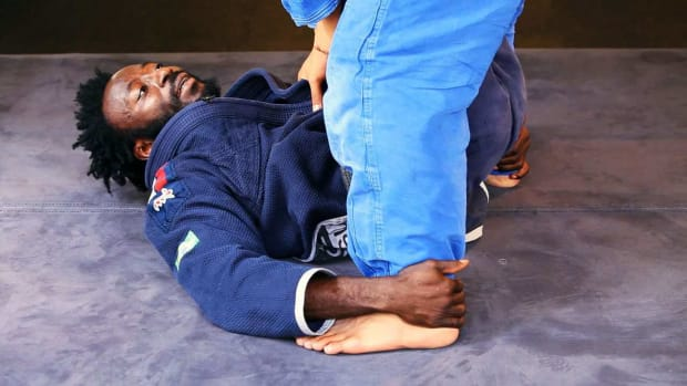Q. How to Do the Double Ankle Grab Sweep in Jiu Jitsu Promo Image