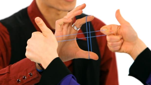 A. How to Escape from Rubber Band Cuffs Office Magic Trick Promo Image
