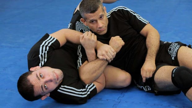 R. How to Do a Rolling Kimura MMA Submission Promo Image